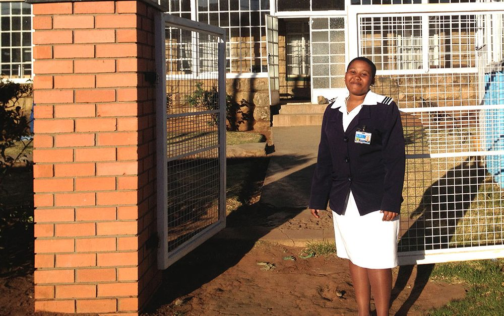 Nurse Tsepiso Jomane outside a health facility.